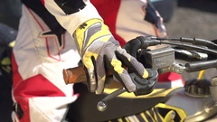 A young man gripping the throttle to rev up his motocross dirt motorcycle. Stock Footage