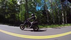 Motorcycle side camera captures long wheelie supermoto Stock Footage