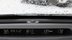 Automotive display: radio frequency, volume, and temperature. Background snow Stock Footage
