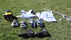 Lacrosse equipment laid out on a grass field. Stock Footage