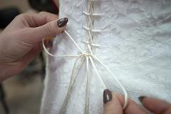 Dressing bride before wedding Stock Photos