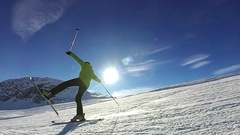 Slow motion: Man is skiing down on one leg on sunny day Stock Footage