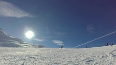 Slow motion: Skier is spraying snow into the camera on sunny day Stock Footage