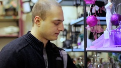 Man chooses souvenir in the gift shop. Stock Footage
