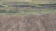 A young man riding his motocross dirt motorcycle off jumps, super slow motion. Stock Footage