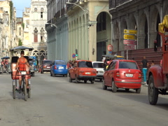 Taxi trishaw is riding on road in center of Havana Stock Footage