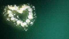 Saint Valentines Day. Shiny Heart Path on Green Background. Stock Footage