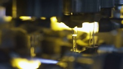 Making of medical tubes from heated glass at the glass-blowing plant Stock Footage