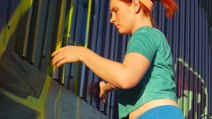 A young woman stretching before working out in urban environment, slow motion. Stock Footage