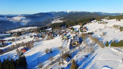 Aerial view of Winter mountains landscape, village Stock Footage
