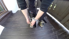 POV of a skier putting on ski boots. Stock Footage