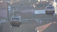 Cable cars above the rooftops of Porto Portugal Stock Footage