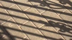 The opening of the gate, shadow at the sidewalk tile. Stock Footage