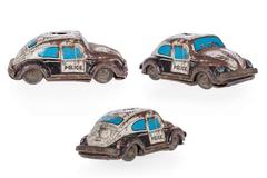 Old, rusty tin toy. Police car isolated on a white background. Stock Photos