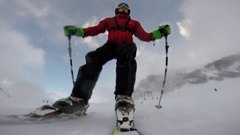 POV of a young man skiing down a snow covered mountain , slow motion. Stock Footage