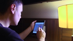 A man using a touch screen tablet PC, checking financial reports Stock Footage