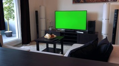 A TV with a green screen in a living room Stock Footage