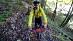 POV of a man mountain biking through a European forest in the mountains. Stock Footage