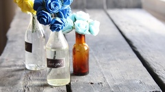 Thank you label and flowers in the bottles Stock Footage