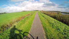 POV of a man riding his bike through a small town in a European countryside. Stock Footage