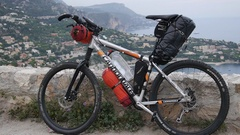 A bike with a scenic view of a European coastal town behind it, slow motion. Stock Footage