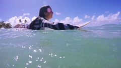 Two Beautiful Attractive Active Girls Paddling Surfing At A Paradisiac Beach Stock Footage