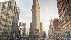 New York City timelapse NYC street traffic people cars Flatiron Building tilt Stock Footage