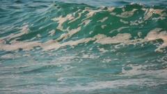Slow motion powerful rolling waves sandy beach water foam summer shoreline Stock Footage