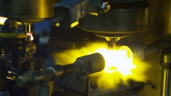 Heating glass with a flamethrower at the glass-blowing factory Stock Footage