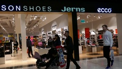People walking in front and shopping inside a shoe store in mall of Scandinavia Stock Footage