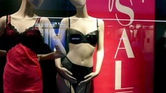 Showcase window of underwear lingerie shop store on sale with people reflection Stock Footage