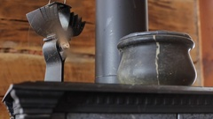 Woodstove fireplace fan circulating air Stock Footage
