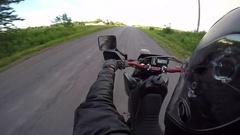 Motorcycle wheelie towards rainbow Stock Footage