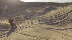 Mx dirt bike sandy berm fun in the pit 4k Stock Footage