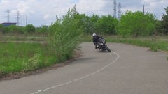 Super slow motion motorcycle taking corner on track Stock Footage