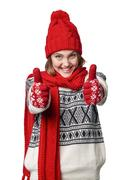Excited winter warm clothing girl giving double thumb up Stock Photos