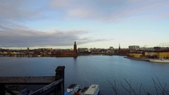A cityscape dolly tracking shot view of Stockholm town hall Center and old town Stock Footage