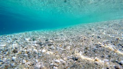 POV diving explore underwater sea silver fish water stones bottom point of view Stock Footage