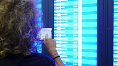 Traveler Searching Flight Information at Timetable in Airport Stock Footage