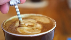 Close Up Latte Coffee with Thick Froth Stock Footage