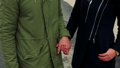 A young, attractive couple holds hands, smiles at the camera and eventually Stock Footage