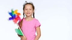 Child with colorful pinwheel toy Stock Footage