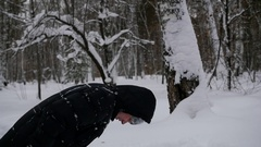 Guy doing a somersault in the snow in the winter park Stock Footage