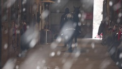 Horse Led into Barn Stable through Snow Stock Footage