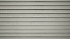 Detail of white closed jalousie at day Stock Footage
