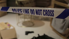 Interior Police Tape with crime scene behind Stock Footage