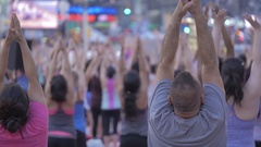 Unrecognisable people do yoga hands urban public space outdoors day summer NYC Stock Footage
