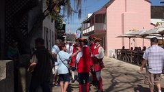Men in traditional red costume in St George Street, St Augustine, Florida, USA Stock Footage