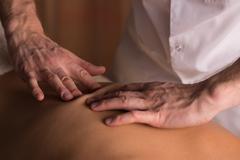 Medical back massage Stock Photos