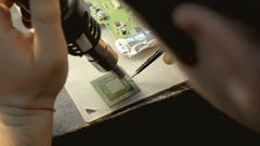 Reparing electronic circuit board Stock Footage